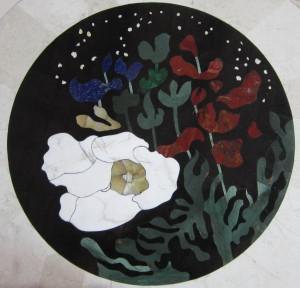 logo submarina, fleurs aquatique, algues. Couleurs dominantes: bleu, vert, rouge, blanc