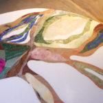 """détail de la table basse """"minérale"""" en marqueteries de pierres dures aux couleurs aciduléespierres"""